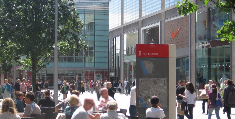 Picture of people sitting in the sun outside Starbucks in Liverpool One