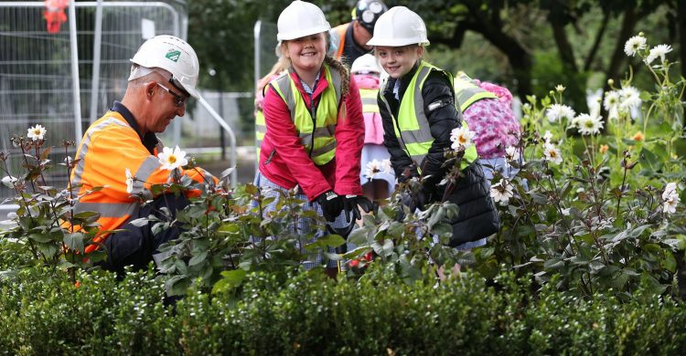 Children from Four Oaks Primary School plant Dahlias in Stanley Park Liverpool with the help  from Willmott Dixon Construction.