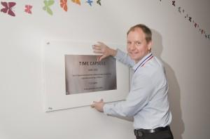 Paul Galloway Morgan Sindall hangs the time capsule plaque