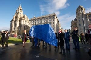 Deputy Mayor Cllr Ann O'Byrne and Julia Baird unveil the statue