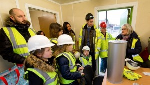 Brownies and families, with MRWA and Cheetham Hill Construction staff, and the time capsule.