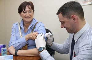 Lord Mayor Roz Gladden receives her flu jab from Kevin Murray from Lloyds Pharmacy